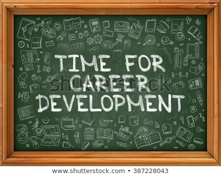 time to development   hand drawn on green chalkboard stock photo © tashatuvango