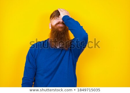 young pretty man with head ache holding hands isolated stock photo © iordani