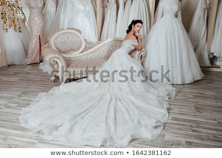 attractive young bride in wedding dress sitting in armchair Stock photo © LightFieldStudios