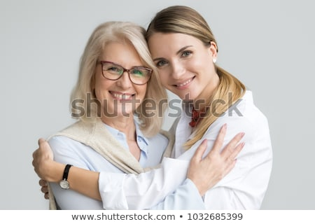 nő · fiatal · lány · átkarol · kint · mosolygó · nő · mosolyog - stock fotó © is2
