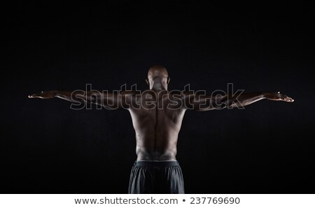 Portrait of a shirtless muscular young man Stock photo © grafvision