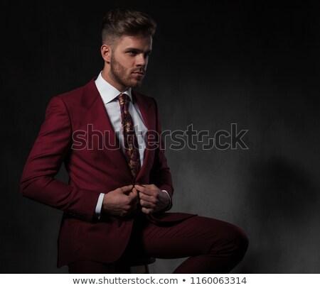 Sitzend Mann Tasten rot Anzug schauen Stock foto © feedough