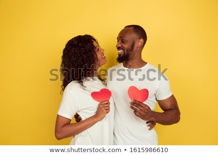 Portrait of an african couple standing Stock photo © deandrobot