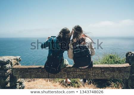 woman with backpack and camera at big sur coast Stock photo © dolgachov