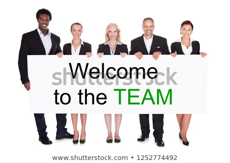 group of businesspeople holding welcome to the team placard stock photo © andreypopov