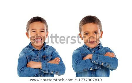 Portre iki genç gülen ikiz kardeşler Stok fotoğraf © deandrobot