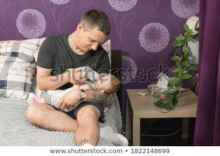 father feeding his little baby daughter stock photo © lopolo