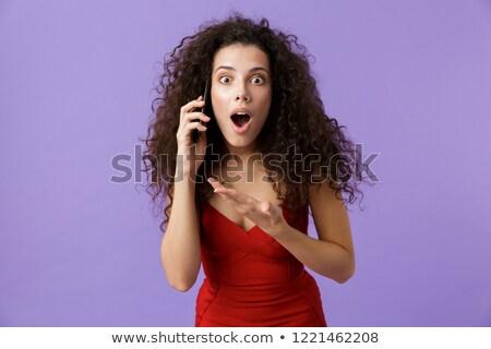 Obraz zachwycony kobieta 20s czerwona sukienka Zdjęcia stock © deandrobot