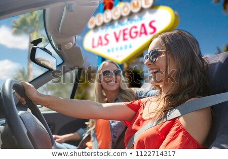 happy young woman in convertible car at las vegas Stock photo © dolgachov