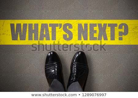 person standing next to whats next text stock photo © andreypopov