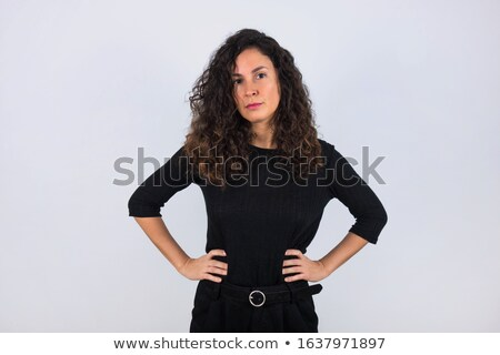 Fashionable beautiful brunette with hands on waist. stock photo © studiolucky