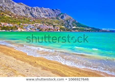 Town of Omis sand beach and Biokovo mountain coastline view Stock photo © xbrchx