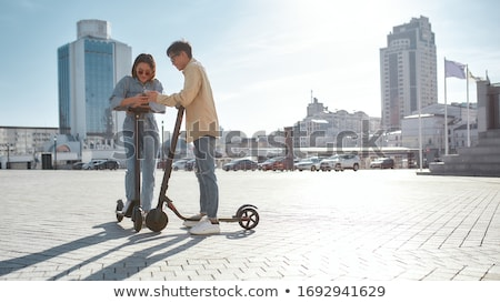 Urban Boys Riding Bicycle and Kick Scooter Stock photo © colematt