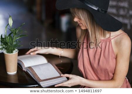 задумчивый девушки Hat сидят кафе таблице Сток-фото © deandrobot