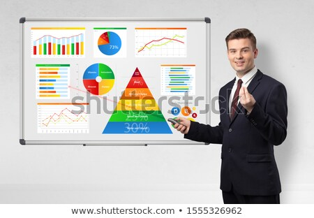 Businessman presenting health reports on white board with laser pointer Stock photo © ra2studio
