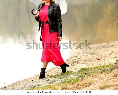 mosolyog · vonzó · lány · piros · pöttyös · ruha · park - stock fotó © dashapetrenko