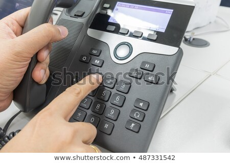Woman's Hand Dialing Telephone Number To Make Phone Call Stock photo © AndreyPopov