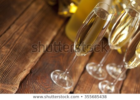 Glasses of champagne on wooden background Stock photo © dashapetrenko