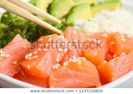 Poke bowl with salmon and vegetables. Stock photo © karandaev