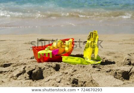 Közelkép játék vödör ásó tengerparti homok játékok Stock fotó © dolgachov