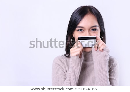 Happy woman customer paying with credit card in fashion showroom Stock photo © boggy