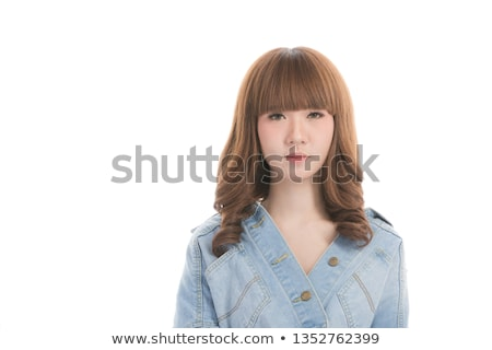 Portrait of happy young female with dark long straight hair, has broad smile, indicates at her mouth Stock photo © vkstudio