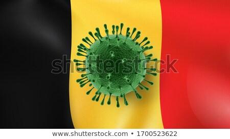 Coronavirus Model on the background of Belgian flag. Stock photo © artjazz