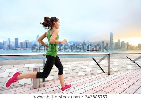 Hong Kong city China travel sightseeing fitness woman jogging at skyline banner panorama . Healthy a Stock photo © Maridav