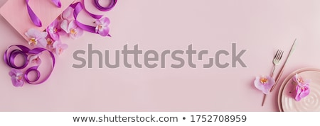 beautiful female with purple orchid stock photo © anna_om