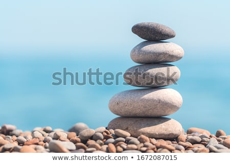 Stock photo: Stack or pile of balancing stones on sea beach