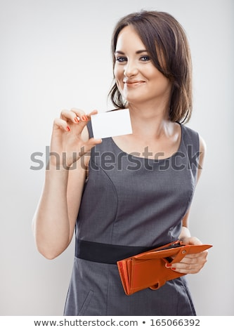 Smiling Caucasian Businesswoman Holding Business Card Isolated W Stock photo © Qingwa