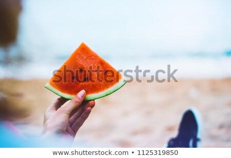 Fille pièce pastèque alimentaire visage Photo stock © ddvs71