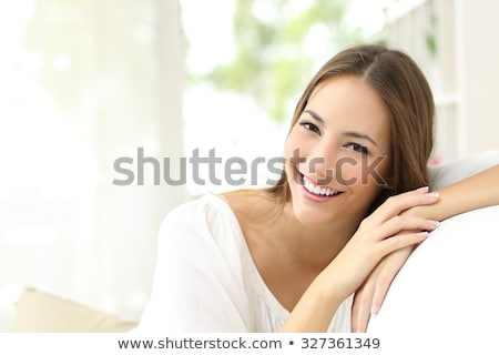 Portrait of smiling beautiful young brunette woman at home stock photo © HASLOO