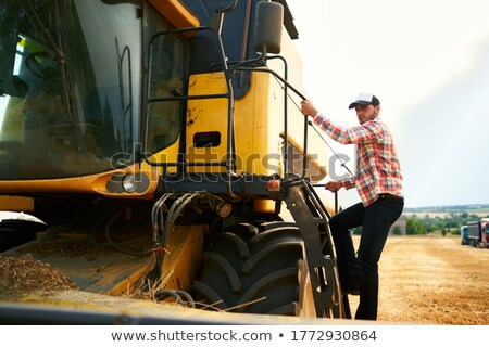 Farmer getting into tractor Stock photo © photography33