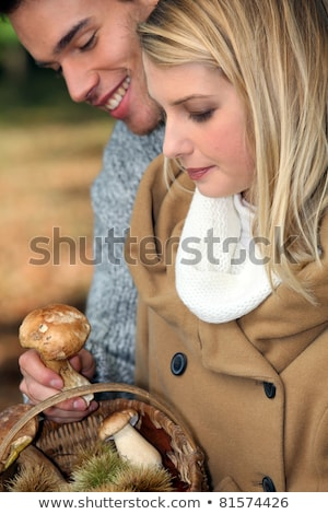 young couple gathering wild mushrooms stock photo © photography33