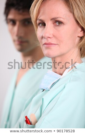 Blond nurse stood with male colleague Stock photo © photography33