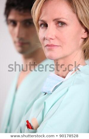 médico · do · sexo · masculino · enfermeira · óculos · de · proteção · cara · máscara - foto stock © photography33