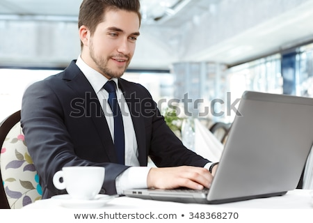 portrait of handsome young businessman all smiles with laptop stock photo © photography33