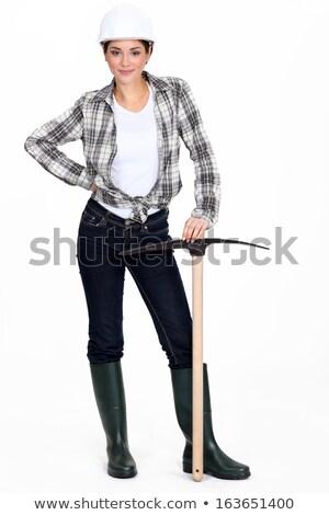Tradeswoman holding a pickaxe Stock photo © photography33