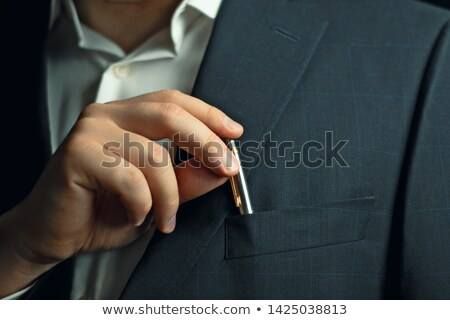 businessman putting a pen in his pocket stock photo © photography33