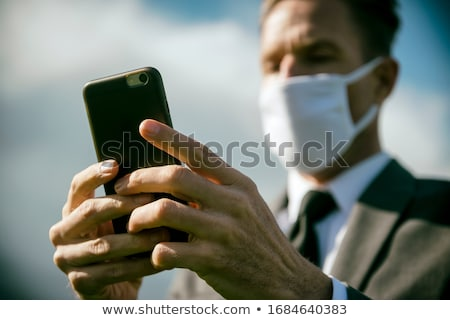 Businessman face mask Stock photo © RTimages