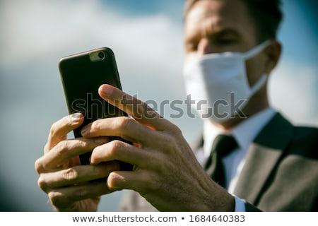 üzletember arc maszk rejtőzködik arculat mögött Stock fotó © RTimages