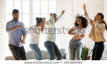 Group of friends celebrating on moving day Stock photo © photography33