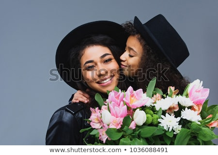 Fashionable young kid kissing her mother Stock photo © stockyimages