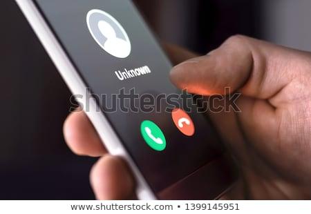 Smart телефонов подвесной оказывать группа Сток-фото © georgejmclittle