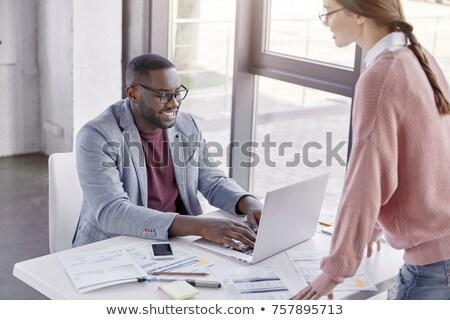 Ethnic businessman at a computer Stock photo © wavebreak_media