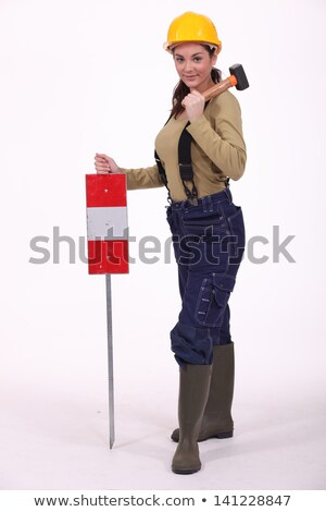 Woman with hammer over hershoulder signaling Stock photo © photography33