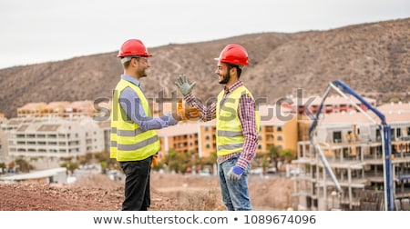 Engineer and a construction worker making a pact Stock photo © photography33