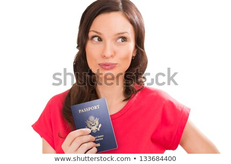 pensive positive woman with a passport isolated over a white bac stock photo © hasloo