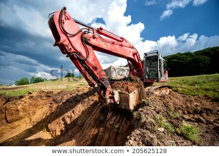 escavadora · trabalhando · montanha · construção · trabalhar · terra - foto stock © mikko